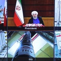 Iranian President Hassan Rouhani is delivering a speech this week during a videoconference in the capital Tehran. He is seen next to views of Iran's Natanz uranium enrichment plant.