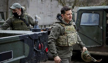 Ukraine's President Volodymyr Zelenskiy visits positions of armed forces near the frontline with Russian-backed separatists in Donbass region