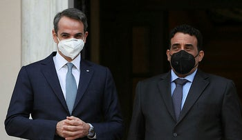 Greek Prime Minister Kyriakos Mitsotakis welcomes the head of the Presidential Council of Libya Mohamed al-Menfi, on Wednesday.