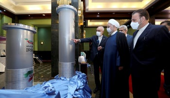 Hassan Rohani, second from right, listens to the head of the Atomic Energy Organization of Iran Ali Akbar Salehi while visiting an exhibition of Iran's new nuclear achievements in Tehran, last week.