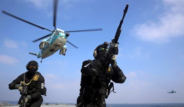 Iranian soldiers in a joint exercise of the Russian navy, the Iranian navy and the Revolutionary Guards' navy.