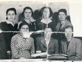 A photo smuggled into Auschwitz in a piece of soap, of young Haredi women including two from the Zehnnerschaft – standing, upper right, Pearl Benisch, and Rivka Horowitz, second from left.