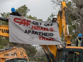 Demonstrators protest the extension of Jerusalem's light rail line into the Gilo neighborhood, over the Green Line, this past December.  Ohad Zwigenberg