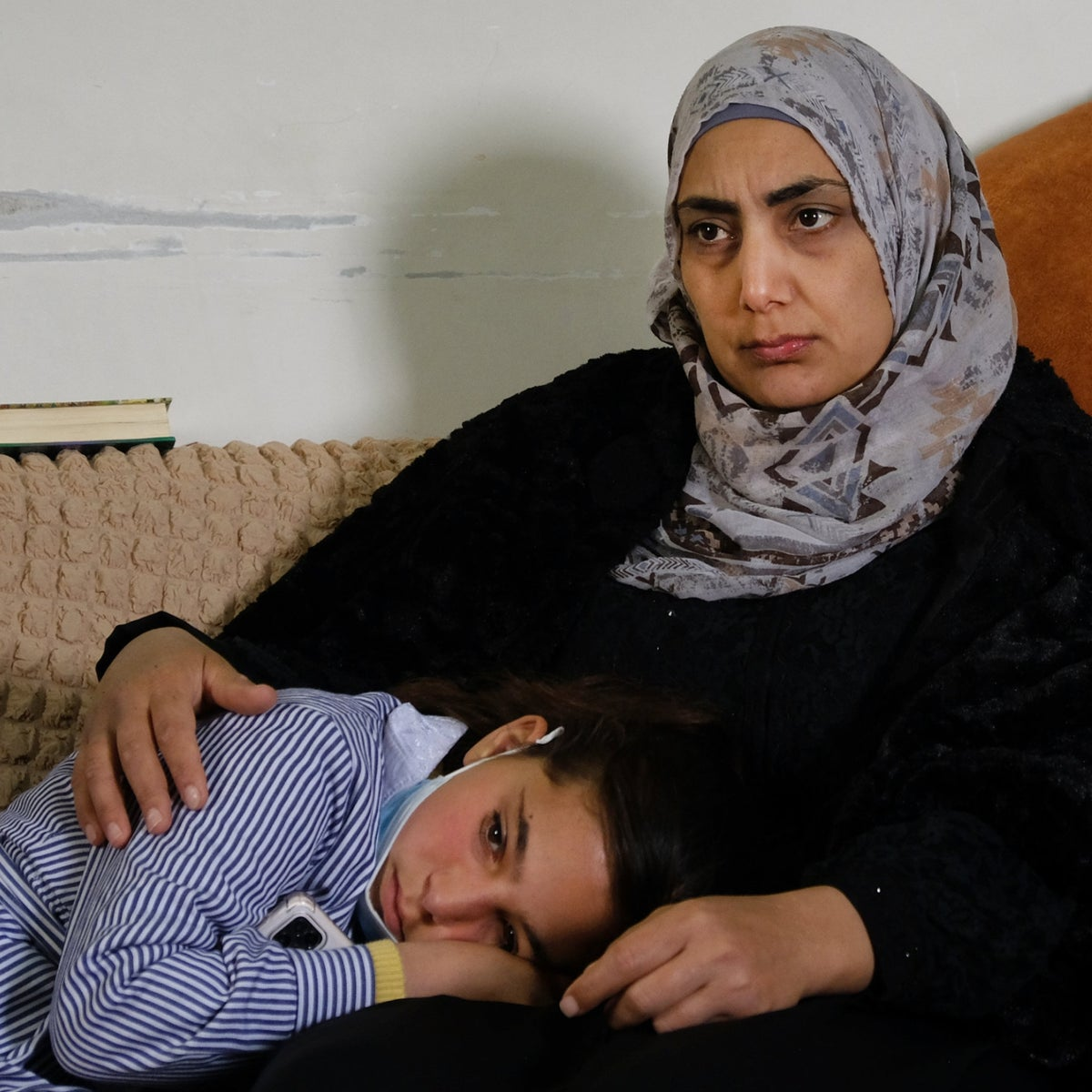 The widow Somaya Mansour and her daughter Nisan at home, this week.