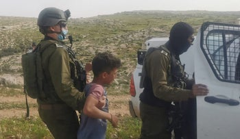 Israeli soldiers arresting a Palestinian child in the West Bank, last month.