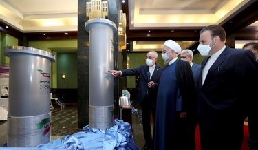 Iranian President Hassah Rouhani examines Iran's newest nuclear facilities at an exhibition in Tehran, last week