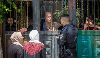 Israeli police officer at a Palestinian family's home that was evacuated for settlers, in the East Jerusalem neighborhood of Silwan, in 2019.
