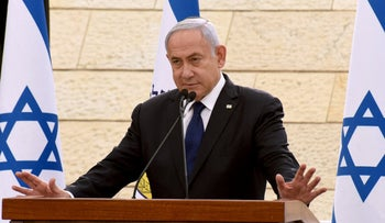 Israeli Prime Minister Benjamin Netanyahu speaks during a ceremony to mark Yom HaZikaron, Israel's Memorial Day for fallen soldiers, at the Yad LeBanim House in Jerusalem on April 13, 2021