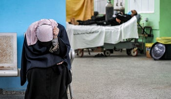A Palestinian woman waiting for her husband at the COVID-19 intensive care unit of al-Shifa Hospital in Gaza City, earlier this month.
