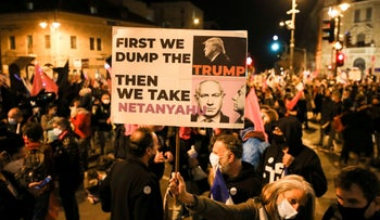 A demonstrator holds a placard during a protest against Prime Minister Benjamin Netanyahu's alleged corruption and his handling of the coronavirus crisis, in Jerusalem, in January.