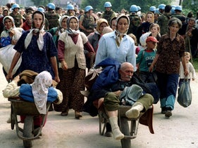 Bosnian Muslim refugees from Srebrenica, fleeing the eastern Bosnian village of Potocari to Bosnian Muslim-held Kladanj near Olovo. July 13, 1995