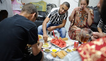 An Israeli family gathers to break the fast during the month of Ramadan, in Acre.
