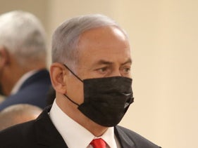 Benjamin Netanyahu departs a meeting with Naftali Bennett at the Knesset, today.