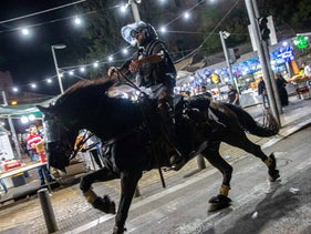 A mounted riot police officer at Damascus Gate in the Old City of Jerusalem, yesterday.