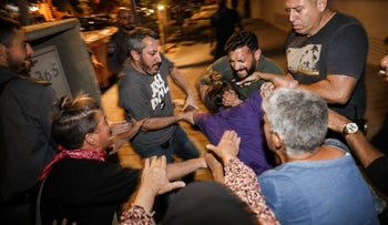 A protester being detained in Jaffa, tonight.