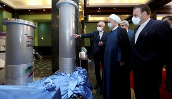 Iranian President Hassan Rouhani listens to the head of the Atomic Energy Organization of Iran Ali Akbar Salehi while visiting an exhibition of Iran's new nuclear achievements in Tehran, two weeks ago.