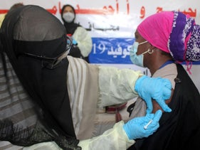 A Yemeni medical worker receives a dose of the AstraZeneca COVID-19 vaccine at a vaccination centre in the al-Maala district of Aden, today.
