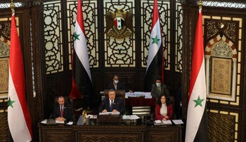 Hammouda Al-Sabbagh, head of the Syrian People's Assembly presides a parliamentary session to discuss upcoming presidential elections, in the capital Damascus.
