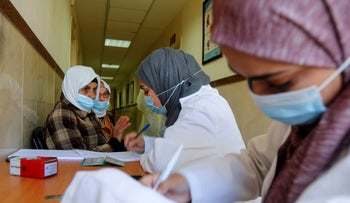 Health workers at a vaccination drive in the West Bank in March.