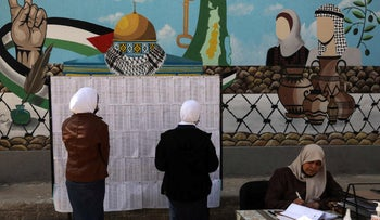 Palestinian women look for their names on the electoral roll at a school in Gaza City, last month.