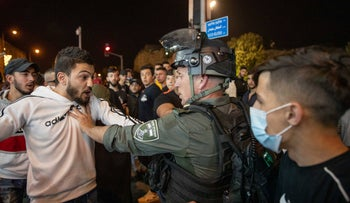A police officer and protesters in Jerusalem, this week.