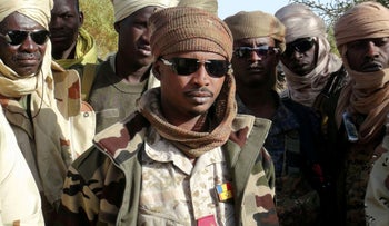 The son of Chad's late president Idriss Deby, Mahamat Idriss Deby Itno and Chadian army officers gather in the northeastern town of Kidal, Mali, 2013.