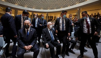 Israeli Prime Minister Benjamin Netanyahu, left, and President Reuvin Rivlin, center, at a Memorial Day ceremony in Jerusalem, last week