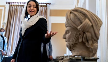 Ambassador Roya Rahmani displays looted and stolen Afghan religious relics and antiquities recovered by U.S. government authorities at the Afghanistan Embassy in Washington.