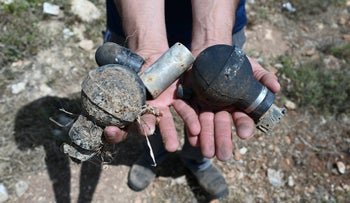 Tear gas and stun grenades fired at the Palestinian workers in Deir Nidham. April 2021.