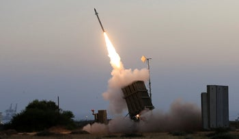 An Iron Dome air defense system located in the Israeli city of Ashkelon fires to intercept a rocket fired from the Gaza Strip