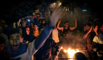 Protests in the Gaza Strip against increasing tensions in Jerusalem, Friday night.