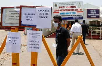 Notices about the shortage of COVISHIELD, a coronavirus disease vaccine manufactured by Serum Institute of India, outside a COVID-19 vaccination centre in Mumbai, India this month