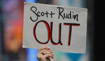 A protester holding a sign calling for Scott Rudin's ouster from Broadway, during a demonstration in New York over the weekend.