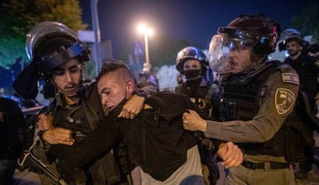 Police arrest a protester during clashes at Herod's Gate in Jerusalem, yesterday.