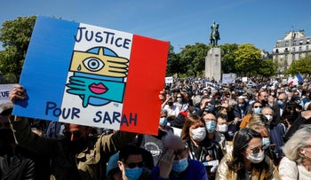 A sign reads 'Justice for Sarah' at a protest in Paris today.