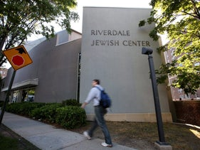 A man walks past the Riverdale Jewish Center in the Bronx borough of New York, in 2019.
