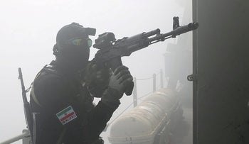 A member of the Islamic Revolution Guards Corps navy participates in a joint naval exercise between Iran and Russia in the Indian Ocean, two months ago.