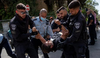 Police arresting a protester at the demonstration in front of the Prime Minister's Residence in Jerusalem, Saturday.