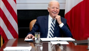 President Joe Biden speaks during a virtual meeting with Mexican President Andres Manuel Lopez Obrador, in the Roosevelt Room of the White House in Washington.