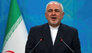 Iran's Foreign Minister Zarif speaks during a joint press conference with his Iraqi counterpart in Baghdad, today.