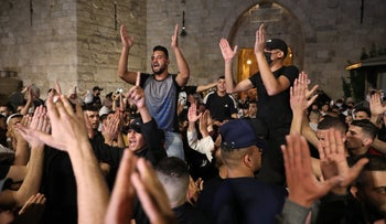 Young Palestinians celebrate after police barriers at Jerusalem's Damascus Gate plaza were removed, on Sunday.