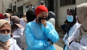 Palestinian Health Department teams mourn the death of fellow medic after being infected with COVID-19 at Gaza's al-Shifa Hospital, on Monday.