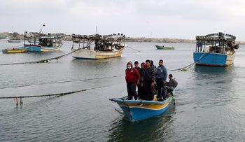 Palestinian fishermen make their way back after Israel restricted Palestinian fishing zone, in Gaza, earlier this week.