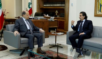 President Michel Aoun meets with Lebanese composer Samir Sfeir at the presidential palace in Baabda, in 2018.