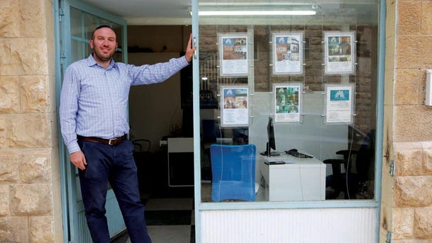 Man standing outside his office