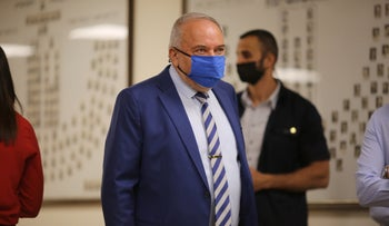 Avigdor Lieberman arrives for a meeting with Yair Lapid at the Knesset, this month.