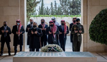 King Abdullah II and members of the royal family pray at the tomb of the late King Hussein in Amman two weeks ago.
