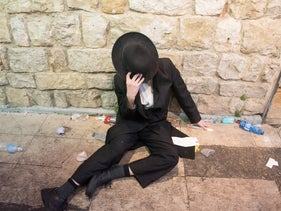 An ultra-orthodox man at the scene in Mt. Meron, northern Israel, today.