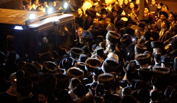 Mourners gather for the funeral of Eliyahu Cohen, who died during Lag BaOmer celebrations at Mt. Meron in northern Israel, April 2021.