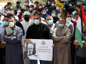 Supporters of the Hamas movement take part in a rally against the decision of the PA to postpone elections, April 2021.